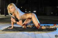 Oiled Action Babe in Sexy Boots - pics 13