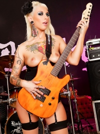 Tattooed Blond Plays the Guitar