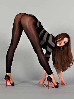 Leggy Beauty Poses in her Shiny Pantyhose and Red High Heels