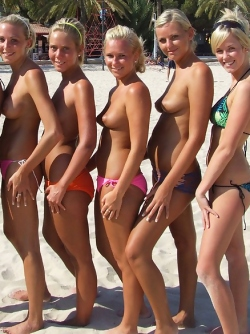 Six Amateur Topless Girls Having Some Fun in a Sunny Beach