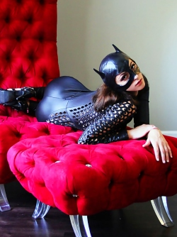 Big Titted Catwoman Carlotta Champagne Stripping on the Chair