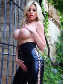 Busty Blonde Demon Emma C in Skin Tight Black Latex Catsuit
