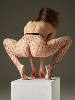 Toned Temptress Flora in Fishnet