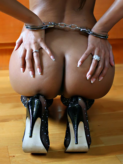 Exotic Model Thitima Posing in Handcuffs and Sexy Stockings