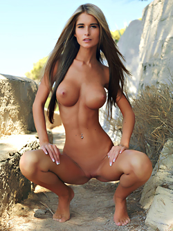 Tall and Busty Beauty Nessa Devil Posing Naked on the Rocks