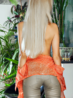 Stately Beauty Xena Wearing Nothing But a Blouse and Tight Pants