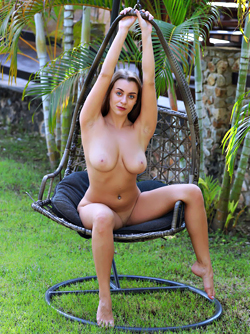 Real Busty Bobmshell Josephine Swinging Naked in the Garden