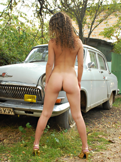 Curly Brunette Amateur Katarzhina Posing Naked by an Oldtimer Car