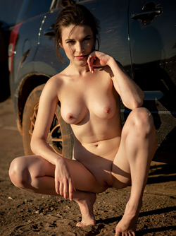 Young natural girl Serena Wood's Stripping in Sunset by her Car